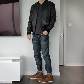 Black Leather Bomber Jacket Outfits For Men: For a casual and cool outfit, go for a black leather bomber jacket and charcoal jeans — these pieces fit nicely together. Brown leather low top sneakers are an easy pick here.