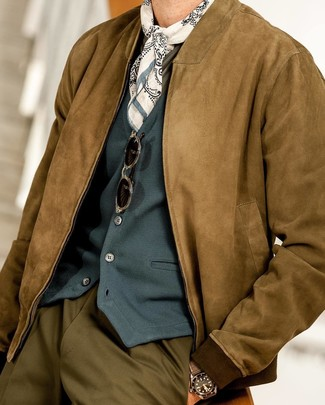How to wear: brown suede bomber jacket, teal waistcoat, olive long sleeve t-shirt, olive dress pants