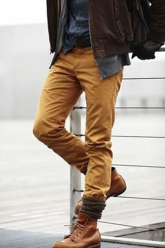 How to wear: dark brown leather bomber jacket, grey zip sweater, navy denim shirt, mustard chinos