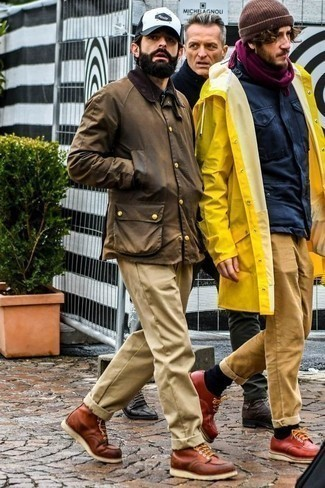 How to Wear Casual Boots For Men: Pairing a brown barn jacket with khaki chinos is a nice choice for a casual but sharp getup. Wondering how to complete your getup? Finish with a pair of casual boots to class it up.