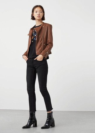 How to wear: brown leather biker jacket, black floral crew-neck sweater, black skinny jeans, black leather ankle boots