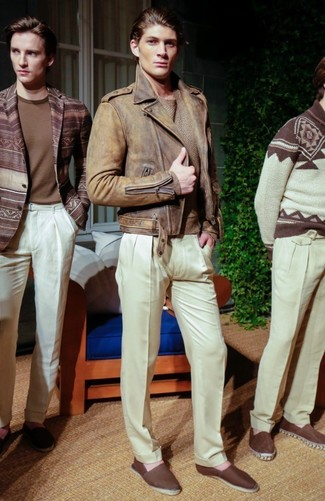How to wear: brown leather biker jacket, tan crew-neck sweater, white dress pants, dark brown canvas espadrilles