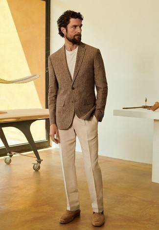 How to Wear a Beige Crew-neck T-shirt For Men: A beige crew-neck t-shirt and khaki dress pants are a combo that every fashion-savvy gent should have in his menswear collection. Bring a more informal twist to your outfit by slipping into a pair of tan suede espadrilles.