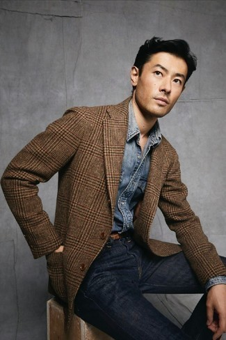 Blue Denim Shirt Outfits For Men: Reach for a blue denim shirt and navy jeans to create a laid-back and cool ensemble.