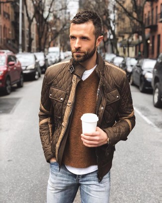 How to wear: brown quilted bomber jacket, brown v-neck sweater, white crew-neck t-shirt, blue jeans