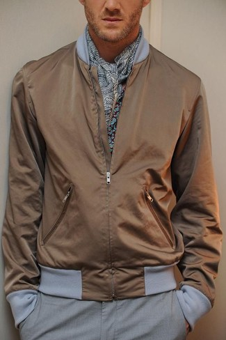 How to Wear a Grey Paisley Scarf For Men: For a look that's very straightforward but can be manipulated in many different ways, rock a brown bomber jacket with a grey paisley scarf.