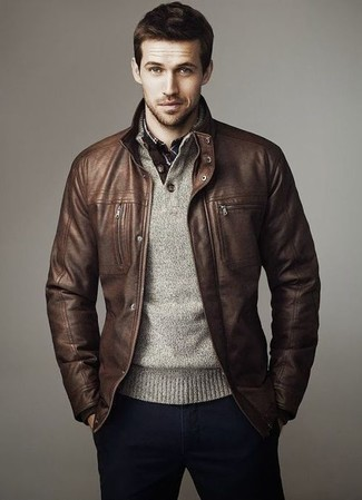 The versatility of a brown leather bomber and deep blue chinos makes them investment-worthy pieces.