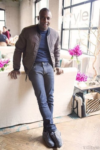 How to wear: brown bomber jacket, navy crew-neck t-shirt, navy jeans, grey suede athletic shoes
