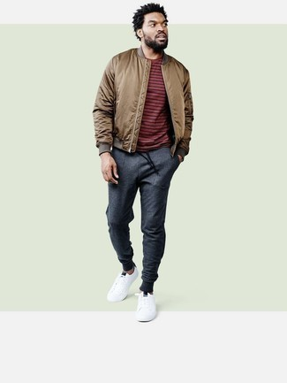 How to Wear a Brown Bomber Jacket For Men: If you're looking to take your casual style to a new height, make a brown bomber jacket and charcoal chinos your outfit choice. Add a more relaxed aesthetic to with a pair of white leather low top sneakers.