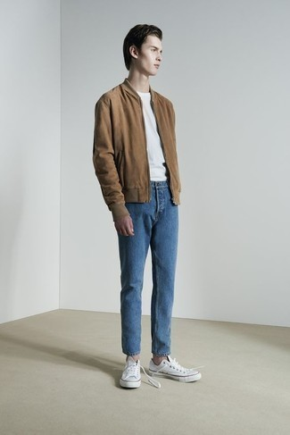Teen Boy Fashion: What To Wear: Such pieces as a brown suede bomber jacket and blue jeans are an easy way to inject subtle dapperness into your casual styling routine. White canvas low top sneakers integrate effortlessly within a variety of looks.