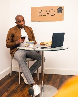 Chinos Outfits: For a laid-back and cool look, reach for a brown bomber jacket and chinos — these pieces fit nicely together. Feeling adventerous? Dress down this look by sporting a pair of white canvas low top sneakers.