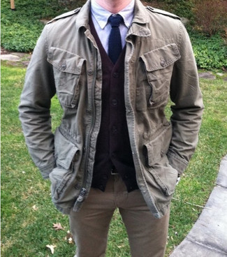Try pairing a brown cardigan with khaki jeans to effortlessly deal with whatever this day throws at you. When it's one of those gloomy fall days, sometimes only a kick-ass look like this one can get you to face the outside world.
