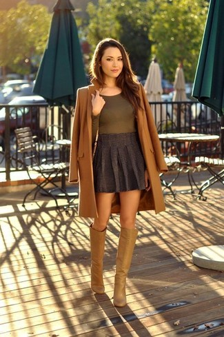 How to wear: brown coat, olive long sleeve t-shirt, charcoal pleated mini skirt, tan leather knee high boots