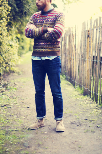 How to wear: brown fair isle crew-neck sweater, blue long sleeve shirt, navy jeans, tan suede desert boots