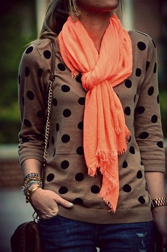 How to wear: brown polka dot crew-neck sweater, navy skinny jeans, dark brown leather crossbody bag, orange scarf