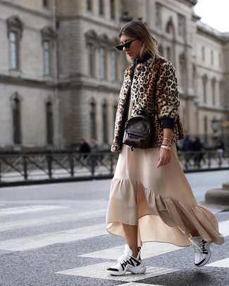 How to wear: brown leopard fur jacket, beige ruffle maxi dress, white and black athletic shoes, dark brown leather backpack