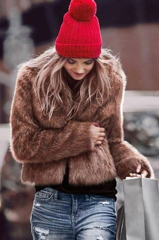 How to wear: brown fur jacket, black turtleneck, blue ripped boyfriend jeans, red beanie