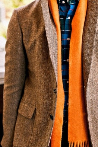 A brown herringbone blazer and an orange scarf are absolute staples if you're planning a polished wardrobe that matches up to the highest fashion standards. When you have one of those gloomy autumn days, sometimes only a knockout getup like this one can cheer it up.