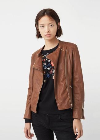 How to wear: brown leather biker jacket, black floral crew-neck sweater, black skinny jeans