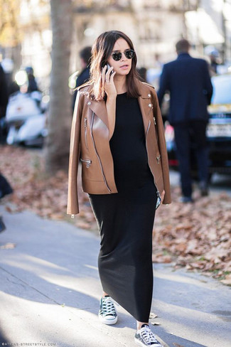 How to wear: brown leather biker jacket, black maxi dress, black and white canvas low top sneakers
