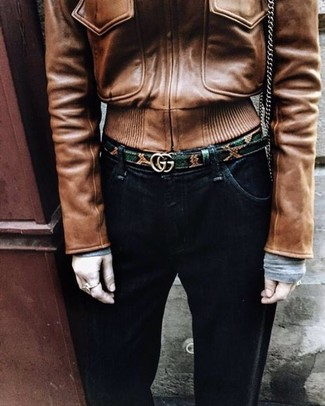 How to wear: brown leather bomber jacket, black jeans