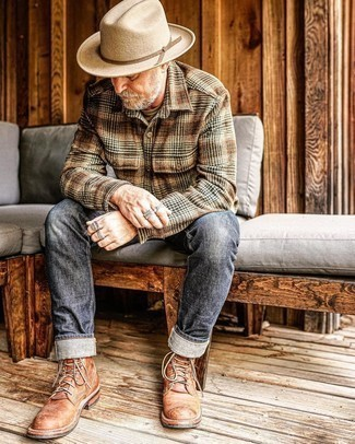 Charcoal Jeans Outfits For Men After 50: This combo of a brown plaid flannel long sleeve shirt and charcoal jeans is a safe and very fashionable bet. Go off the beaten path and switch up your look by rocking brown leather casual boots. This outfit is a clear example mature guys can still very well draw compliments.