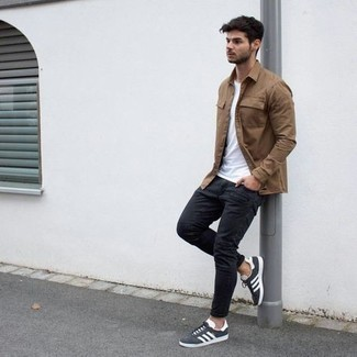Black Skinny Jeans Outfits For Men: One of the coolest ways for a man to style a brown long sleeve shirt is to combine it with black skinny jeans in a relaxed casual outfit. On the shoe front, this look pairs wonderfully with charcoal canvas low top sneakers.