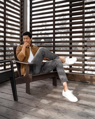Grey Jeans Outfits For Men: A brown corduroy long sleeve shirt and grey jeans are the kind of a winning casual ensemble that you so awfully need when you have no time. When it comes to shoes, complement this ensemble with a pair of white canvas low top sneakers.