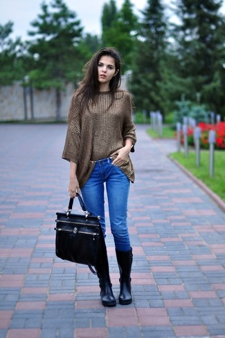 Opt for a brown oversized sweater and jeans for a trendy and easy going look. Throw in a pair of black rain boots for a more relaxed feel.