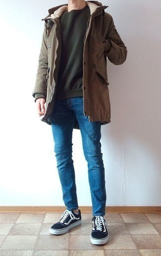 How to Wear Blue Skinny Jeans For Men: If you appreciate relaxed dressing, dress in a brown parka and blue skinny jeans. When it comes to footwear, go for something on the classier end of the spectrum by rounding off with a pair of black and white canvas low top sneakers.