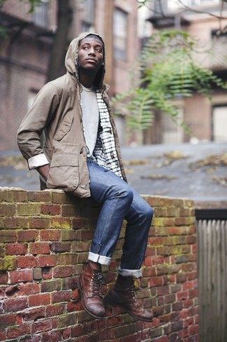 How to wear: brown lightweight parka, grey crew-neck t-shirt, navy jeans, brown leather casual boots