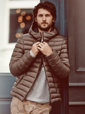 How to wear: brown puffer jacket, grey horizontal striped henley sweater, khaki camouflage chinos