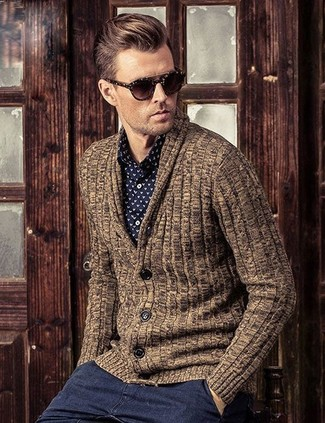 How to wear: brown shawl cardigan, black and white print dress shirt, charcoal chinos, dark brown sunglasses