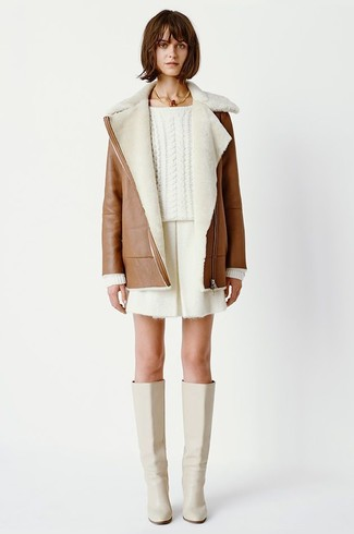 How to wear: brown shearling coat, white cable sweater, white shorts, beige leather knee high boots