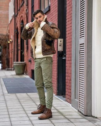 How to wear: brown shearling jacket, white cable sweater, green cargo pants, brown leather casual boots