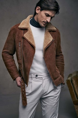 How to wear: brown shearling jacket, white crew-neck sweater, charcoal turtleneck, grey chinos