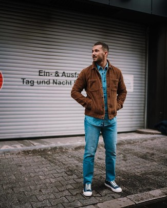 How to wear: brown corduroy shirt jacket, blue denim shirt, blue jeans, navy and white canvas high top sneakers