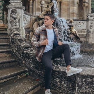 Beige Canvas Low Top Sneakers Outfits For Men: A brown plaid wool shirt jacket and charcoal jeans are a great look worth having in your casual styling arsenal. Why not add a pair of beige canvas low top sneakers to your look for a fun vibe?