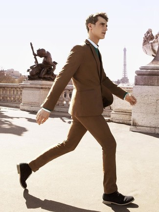 How to wear: brown suit, green crew-neck sweater, white dress shirt, black suede desert boots