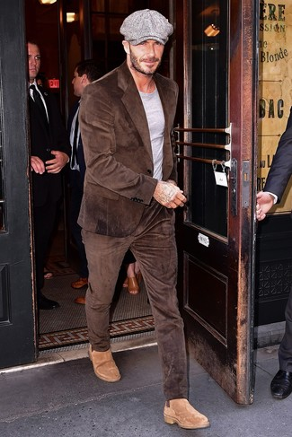 How to wear: brown corduroy suit, grey crew-neck t-shirt, tan suede chelsea boots, grey flat cap
