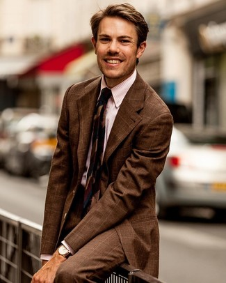 How to Wear a Brown Check Suit: A brown check suit and a pink vertical striped dress shirt are a smart combo that will earn you a great deal of attention.