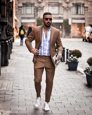 How to Wear a White and Blue Vertical Striped Long Sleeve Shirt For Men: To look modern and stylish, reach for a white and blue vertical striped long sleeve shirt and a brown suit. For a more relaxed feel, why not complement your look with a pair of white leather low top sneakers?