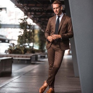 Brown Suit with Dress Shirt Outfits: We love how this pairing of a brown suit and a dress shirt instantly makes any gentleman look stylish and refined. Does this outfit feel too fancy? Invite tobacco leather tassel loafers to jazz things up.