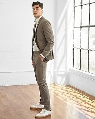White and Red Leather Low Top Sneakers Dressy Outfits For Men: Wear a brown suit with a white dress shirt for a sleek sophisticated getup. For a fashionable hi/low mix, introduce a pair of white and red leather low top sneakers to the equation.
