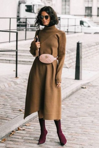 How to wear: brown sweater dress, burgundy elastic ankle boots, pink leather fanny pack, black sunglasses