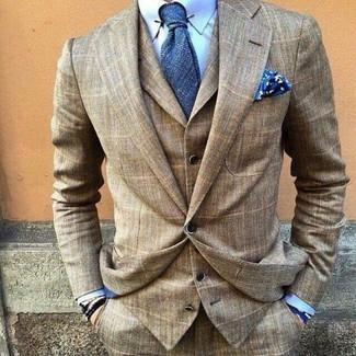How to wear: brown plaid three piece suit, light blue dress shirt, blue tie, blue print pocket square