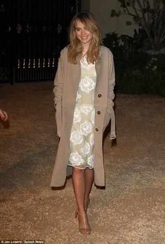 Suki Waterhouse wearing Brown Trenchcoat, White Lace Midi Dress, Tan Cutout Leather Ankle Boots