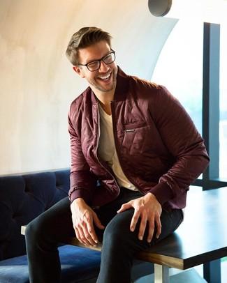 How to wear: burgundy bomber jacket, beige v-neck t-shirt, black skinny jeans
