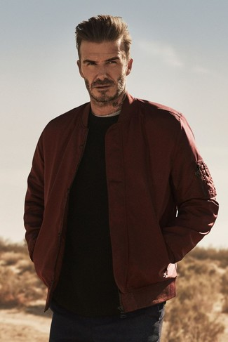 David Beckham wearing Burgundy Bomber Jacket, Black Crew-neck Sweater, Grey Crew-neck T-shirt, Navy Chinos