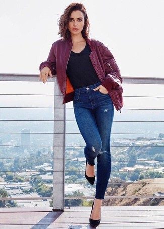 How to wear: burgundy bomber jacket, black crew-neck t-shirt, blue ripped skinny jeans, black suede pumps